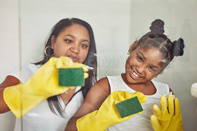 Buy stock photo Cropped shot of a mother and her little daughter cleaning the bathroom together at home