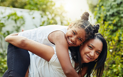 Buy stock photo Shot of a young girl and her mother spending time outdoors