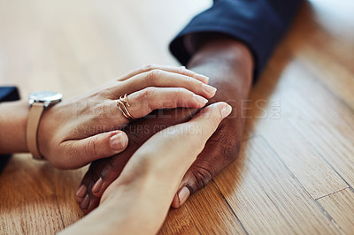 Buy stock photo Cropped shot of a businessman and businesswoman holding hands at a table