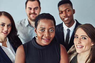 Buy stock photo High angle studio portrait of a group of confident young businesspeople standing together against a grey background