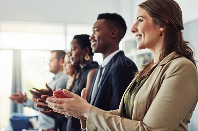 Buy stock photo Shot of a group of young businesspeople clapping during a conference in a modern office