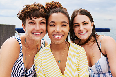 Buy stock photo Portrait of a group of happy young women enjoying a relaxing day on a yacht