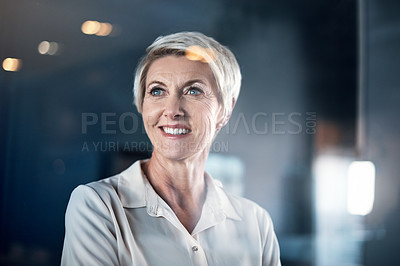 Buy stock photo Shot of a mature businesswoman looking thoughtful while standing in an office