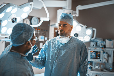 Buy stock photo Shot of two surgeons having a discussion in an operating room