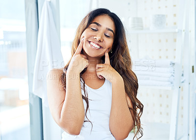 Buy stock photo Cropped shot of a beautiful young woman going through her morning routine