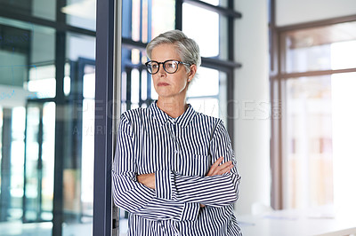 Buy stock photo Shot of an attractive mature businesswoman posing with her arms folded in her office