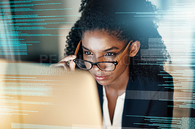 Buy stock photo Shot of a young programmer working on a computer in an office at night