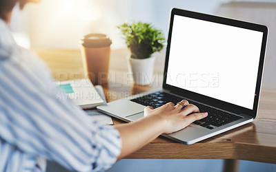 Buy stock photo Shot of an unrecognizable businesswoman working on a laptop in her office