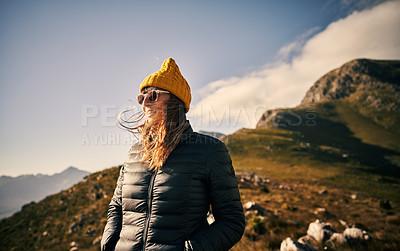 Buy stock photo Cropped shot of a beautiful young woman out mountain climbing