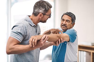 Buy stock photo Shot of a senior man going through rehabilitation with his physiotherapist