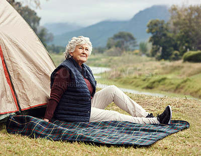 Buy stock photo Full length shot of a senior woman sitting outside of a tent on her chosen camping spot