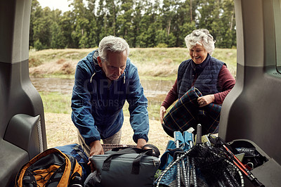 Buy stock photo Cropped shot of an affectionate senior couple unpacking the car at their camping spot
