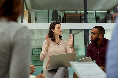Buy stock photo Shot of an attractive businesswoman explaining her ideas during a business meeting with colleagues at work