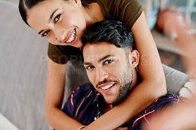 Buy stock photo Portrait of an affectionate young couple spending some quality time together at home