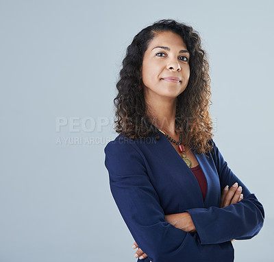 Buy stock photo Cropped portrait of an attractive mature woman standing with her arms folded against a gray background in the studio