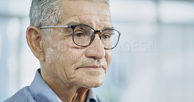 Buy stock photo Cropped shot of a senior man looking thoughtful while sitting alone