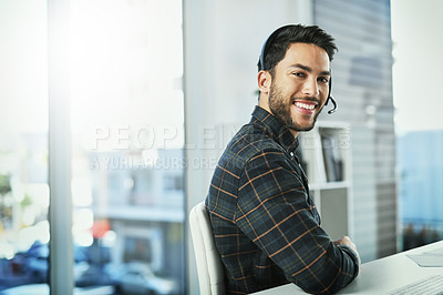Buy stock photo Portrait of a handsome young call centre agent working in his office
