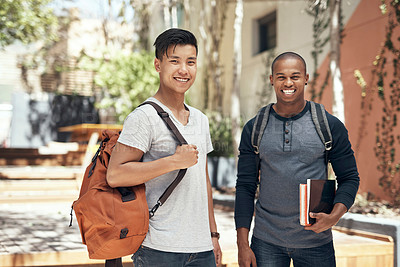 Buy stock photo Portrait of two young men hanging out together on campus outside