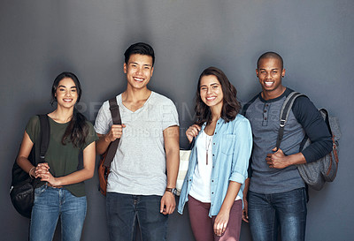 Buy stock photo Studio portrait of a group of young students standing together against a grey background