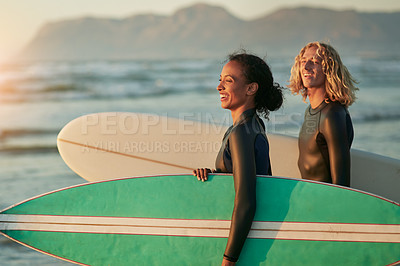 Buy stock photo Shot of a cheerful young couple going surfing at the beach
