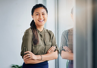 Buy stock photo Portrait of a young businesswoman standing by a window in an office
