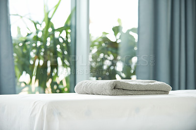 Buy stock photo Shot of a tranquil room with towels on a massage bed during the day