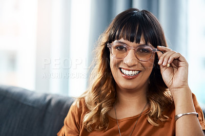 Buy stock photo Cropped shot of a beautiful young woman relaxing on the sofa at home