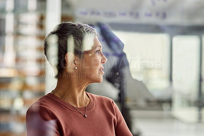 Buy stock photo Cropped shot of a mature businesswoman looking thoughtful in an office