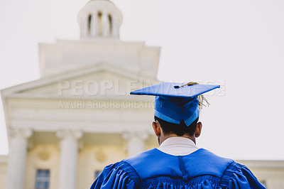 Buy stock photo Rearview shot of a young man on graduation