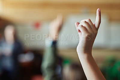 Buy stock photo Cropped shot of an unrecognisable child raising their hand in a classroom