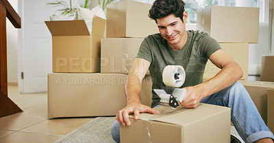 Buy stock photo Shot of a man closing a cardboard box with tape at home