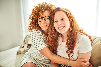 Buy stock photo Portrait of a beautiful mother and daughter embracing while spending some time together at home