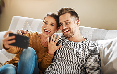Buy stock photo Shot of a couple announcing their engagement while on a video call