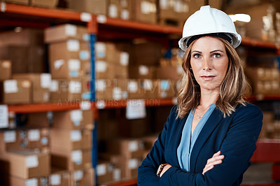 Buy stock photo Shot of a confident young woman working in a warehouse