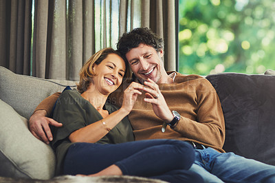 Buy stock photo Shot of an affectionate mature couple relaxing on the sofa at home
