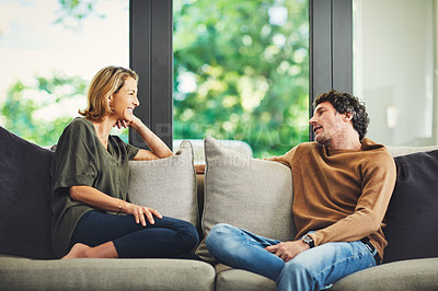 Buy stock photo Shot of a mature couple relaxing and chatting on the sofa at home