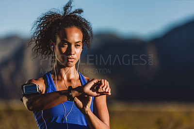 Buy stock photo Cropped shot of a woman checking her wristwatch while out for a run