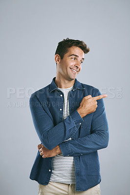 Buy stock photo Cropped shot of a handsome man advertising copyspace