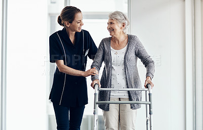 Buy stock photo Shot of a female nurse assisting a senior woman using a walker