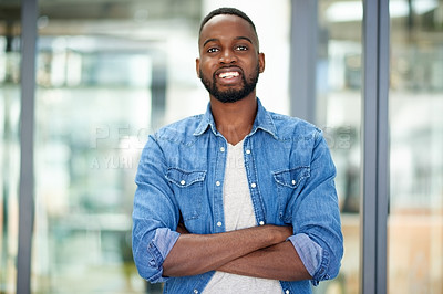 Buy stock photo Portrait of a confident young designer standing with his arms crossed in an office