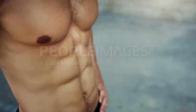 Buy stock photo Closeup shot of a shirtless and muscular man standing outdoors