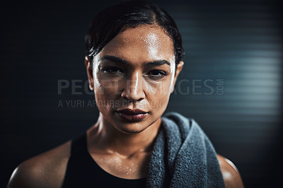 Buy stock photo Portrait of a sporty young woman sweating after her workout