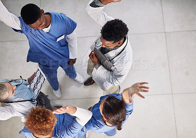 Buy stock photo High angle shot of a group of medical practitioners cheering in a hospital
