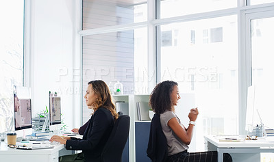 Buy stock photo Shot of a young businesswoman celebrating an achievement in a modern office