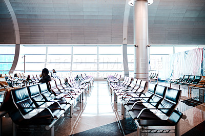 Buy stock photo Shot of rows of chairs in an airport