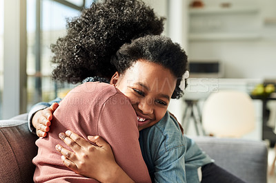 Buy stock photo Cropped shot of a young woman and her daughter sharing a hug