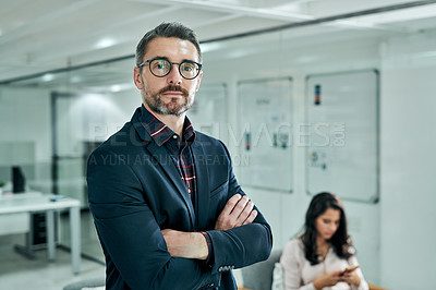 Buy stock photo Cropped shot of a handsome mature businessman standing in the office while his female coworker sits behind him