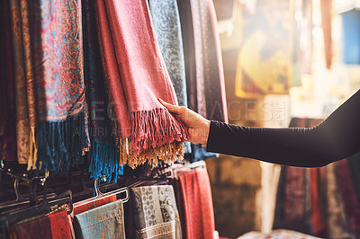 Buy stock photo Cropped shot of a woman shopping for fabric at a local market stall
