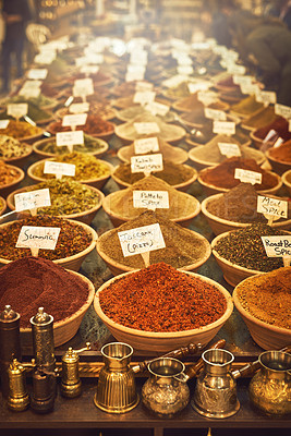 Buy stock photo Shot of an assortment of spices for sale at a market store