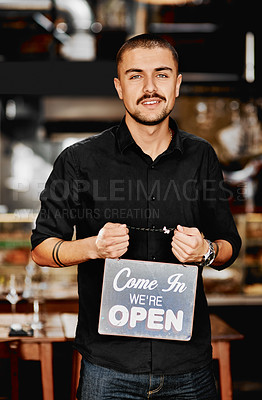 Buy stock photo Portrait of  a handsome young businessman holding an
